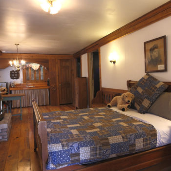 Cottage main room with full size bed in downtown Lake Geneva