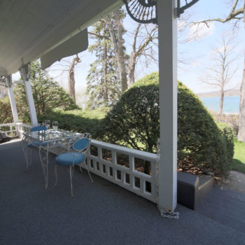 Front veranda overlooking Lake Geneva with swing
