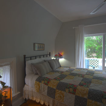 sunrise room with queen bed.