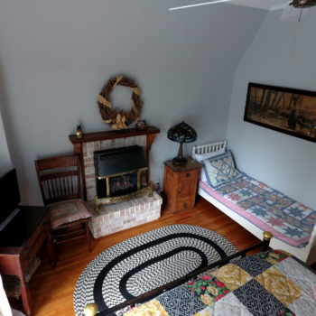 Sunrise room with queen bed on second floor.